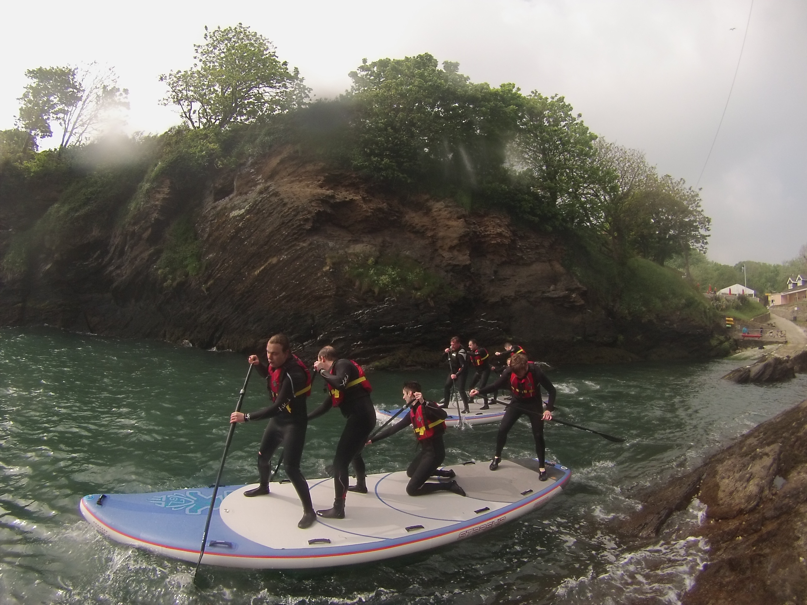 family stand up paddle boarding devon
