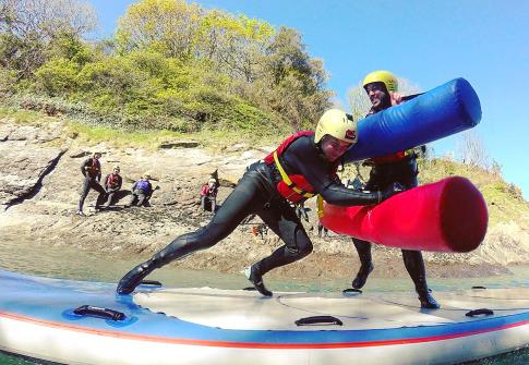 Giant SUP battle, stag weekend, stag ideas, stag do, hen do, watersports devon