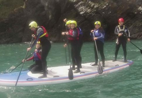 Group stand up paddle boarding Ilfracombe